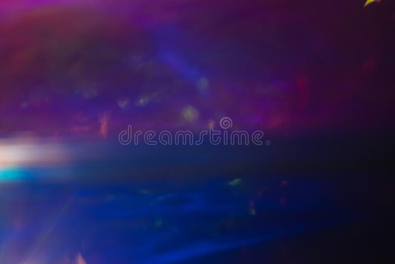 Defocused purple dark blue space lens flare blur. Soft defocused purple dark blue background. Outer space concept. Lens flare blur stock photos