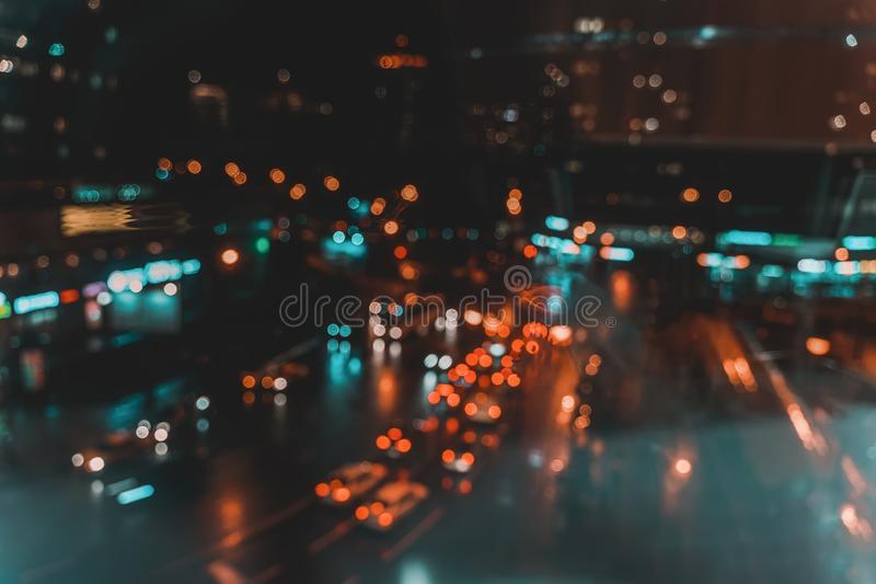 Defocused urban abstract city lights at night, colorful bokeh. Abstract auto, city street, traffic, transportation. Defocused urban abstract city lights at night royalty free stock photography