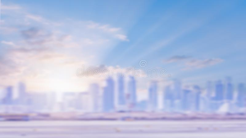 Defocused urban skyline. Blurred city building. Amazing golden warm light sunrise or sunset through skyscrapers. Light city background. Morning sunrise urban royalty free stock images