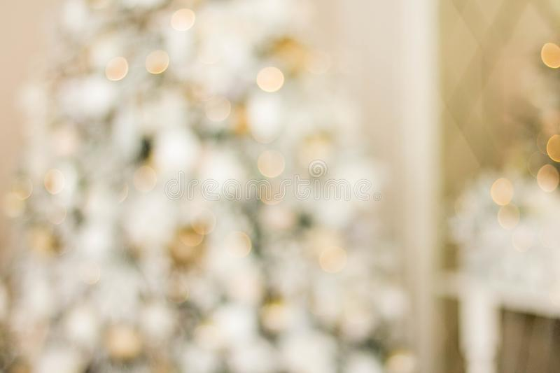 Defocused view. Beautiful Christmas tree with lights against white background royalty free stock photos