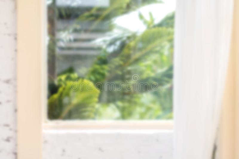 Defocused window background with white curtains in morning time. Blur royalty free stock photo