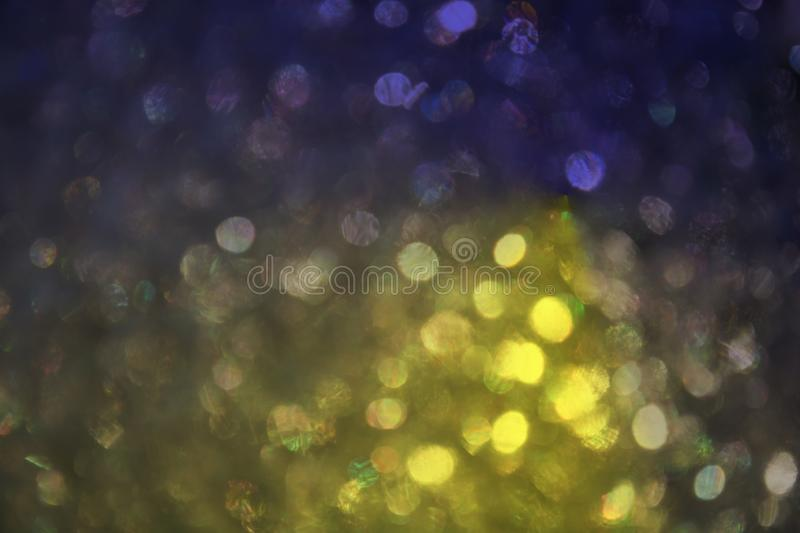 Defocused a wonderful bokeh of soapy foam on blue and yellow tone. Background royalty free stock photo