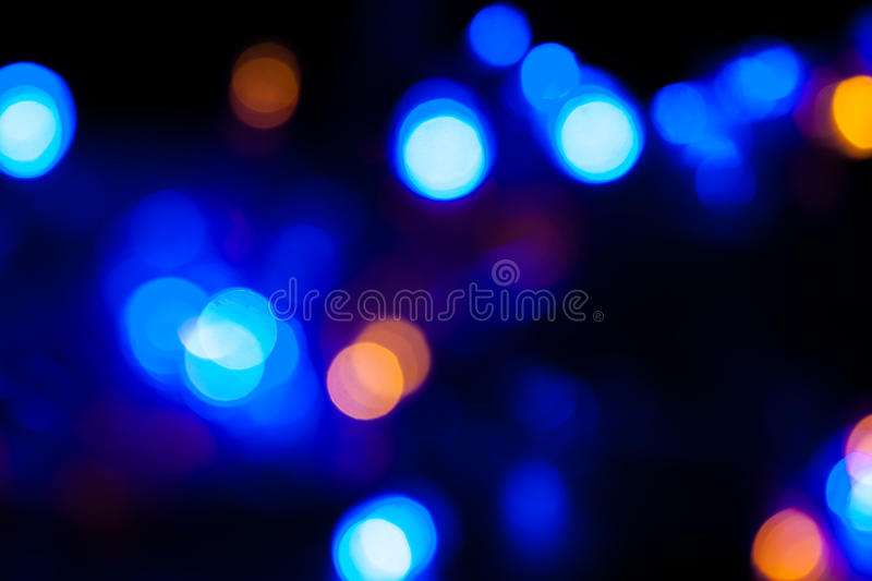 Defocussed bokeh of light spots. Blurred spots of lights bokeh for abstract color background stock photos