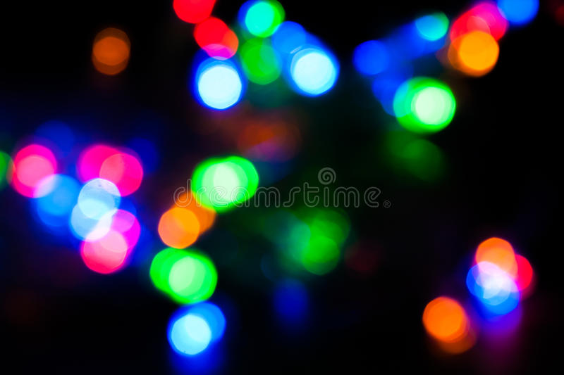 Defocussed bokeh of light spots. Blurred spots of lights bokeh for abstract color background royalty free stock images