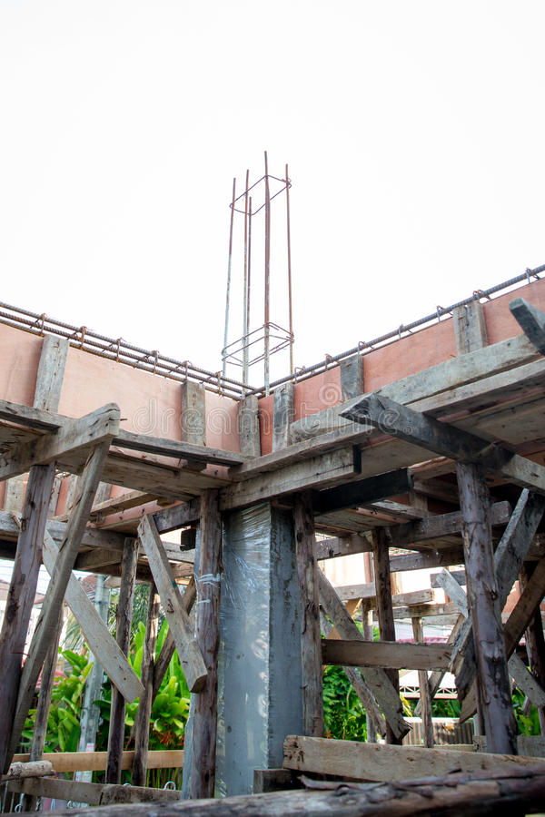 Deformed steel bars frame for beam reinforced steel footing or flooring in construction site. stock photos