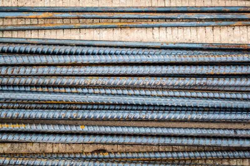 Deformed steel bars metal texture close up. Deformed steel bars for reinforce concrete, metal texture close up royalty free stock images