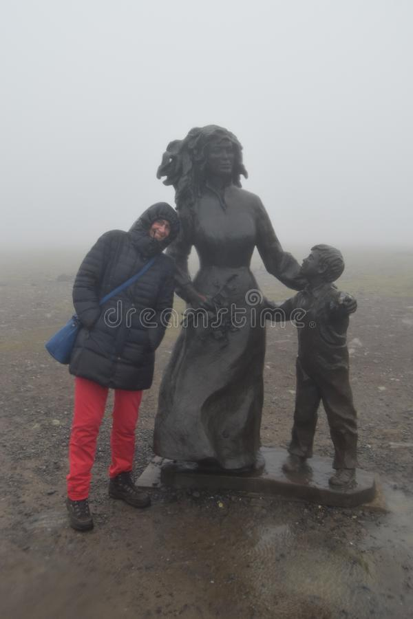 Defying rain, fog and wind at the North Cape Norway. Defying rain, wind and fog at the North Cape, Norway. Smiling with those standing out in the weather every stock photos