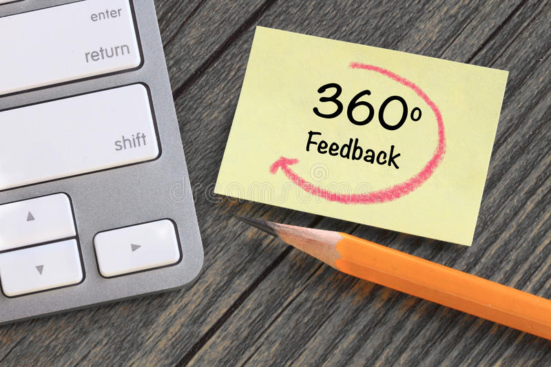 360 degree feedback. Concept of feedback, with desk background stock photography