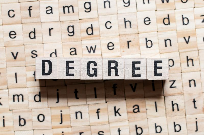 Degree word concept. On cubes stock image