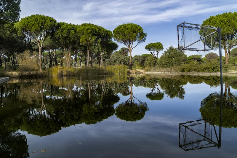 Cloudy sky, green trees, water streams and sports. The Dehesa de Navalcarbon is undoubtedly widely known by the residents of Las Rozas, because located about 2 stock images