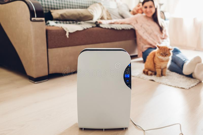 Dehumidifier with touch panel, humidity indicator, uv lamp, air ionizer, water container works at home. Dampness stock photos