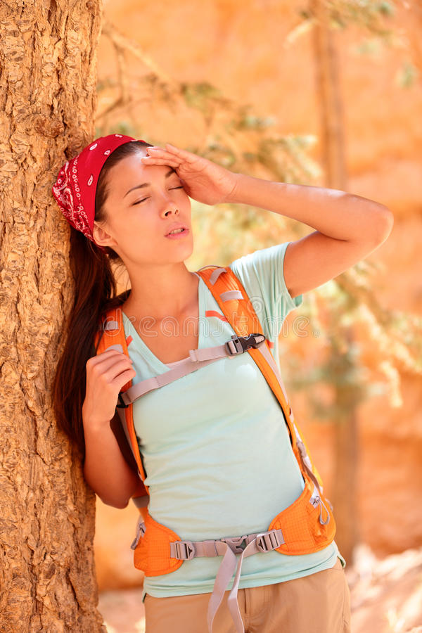 Dehydration thirst heat stroke exhaustion concept. With woman hiker tired, dehydrated and exhausted Bryce Canyon. Girl tired close to heat stroke due to high stock photos