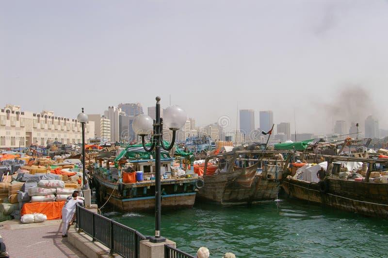 Deira and Bur Dubai: Creek - goods - shipping. Dubai Creek divides the city into two main sections – Deira and Bur Dubai stock photo