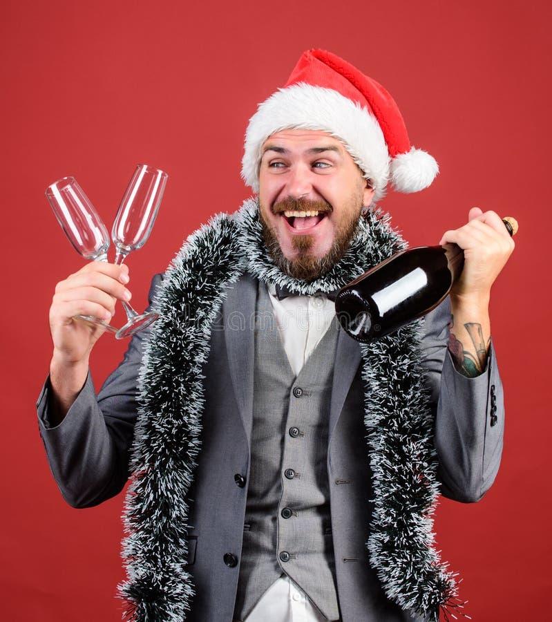 Deja el champán de la bebida Malla del sombrero de Boss santa celebrar Año Nuevo o la Navidad Únase a la celebración de la Navida fotos de archivo