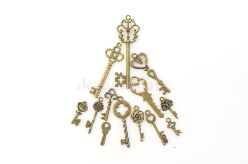 Dekoracyjni klucze różni rozmiary, stylizowany antyk na białym tle Tworzy centerpiece Święta moje portfolio drzewna wersja nosici obrazy royalty free