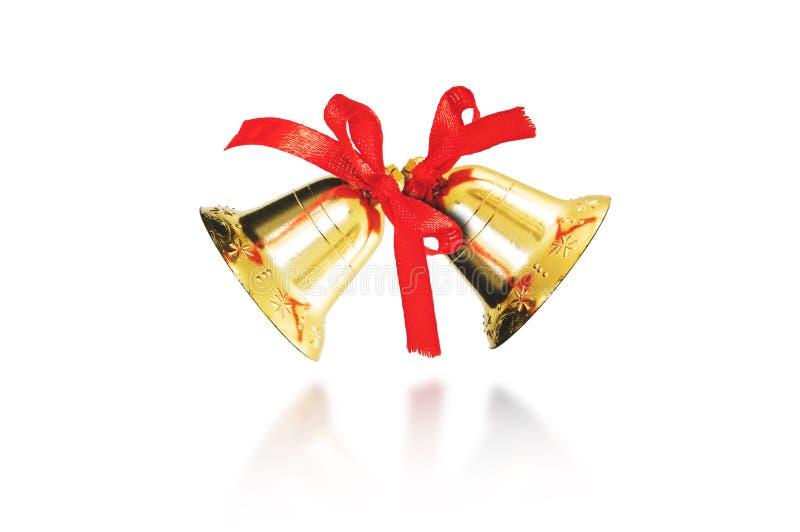 Dekoracyjni złoci dzwony dla bożych narodzeń i nowego roku, odizolowywający na białym tle obrazy royalty free