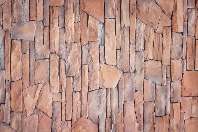Dekoracyjny kolorowy brąz kamiennej ściany tekstury abstrakt dla tła fotografia stock