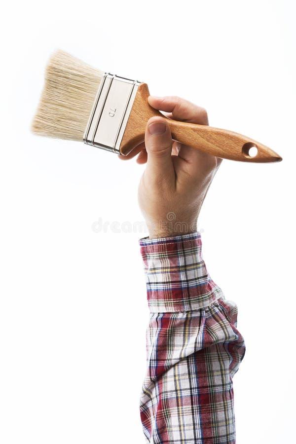 Dekorateur, der einen Malerpinsel hält lizenzfreies stockfoto