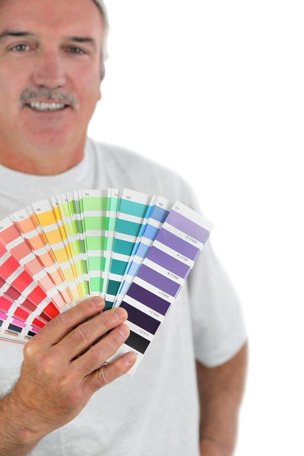 Dekorateurholding-Farbendiagramme stockfoto