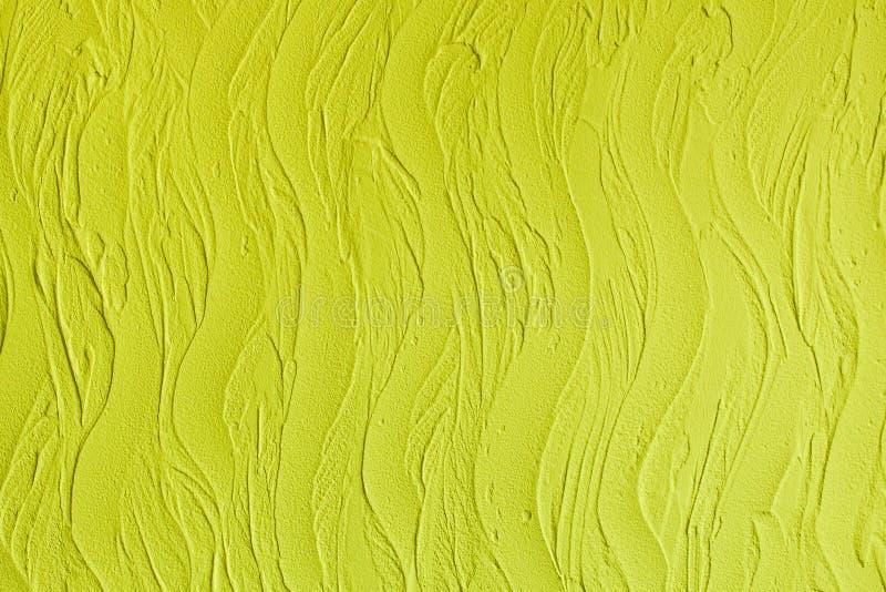 Dekorativ murbruk. Väggstuckaturtextur. I stil vinkar, citronen - gul färg. arkivfoton