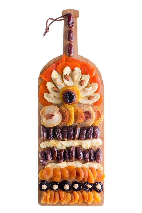 Dekorative Anordnung für Trockenfrüchte und Nüsse lizenzfreie stockfotografie