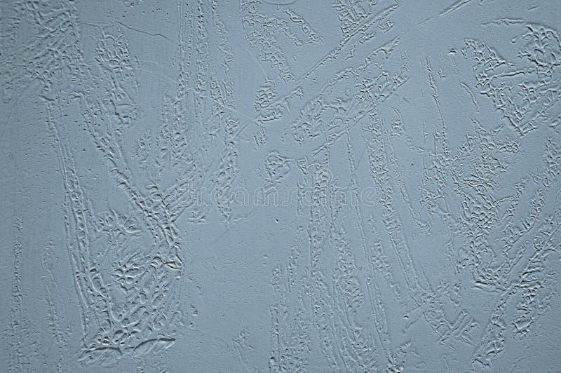 Dekoratives Pflaster Entlastungsbeschaffenheit, auf einem blauen Hintergrund stockbild