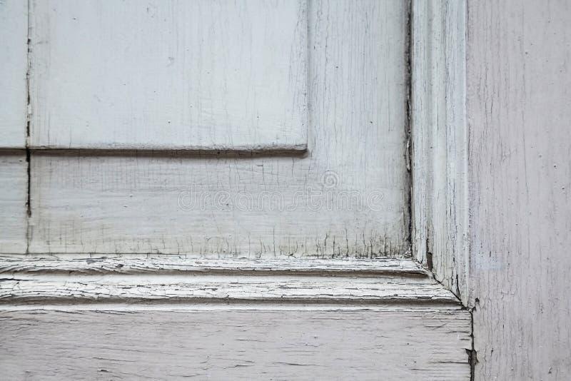 Dekorativt hörn av en trägammal dörr fotografering för bildbyråer