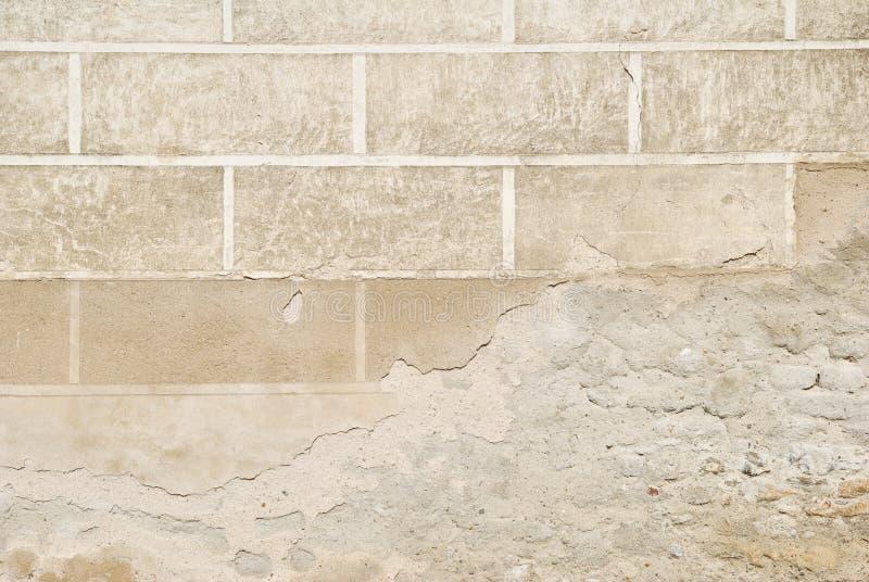 Dekorerad flagnande väggmurbruk texturerar arkivbild
