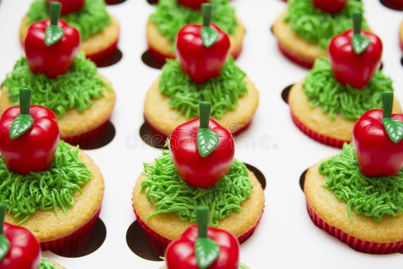 Dekorerad muffinmat arkivbilder