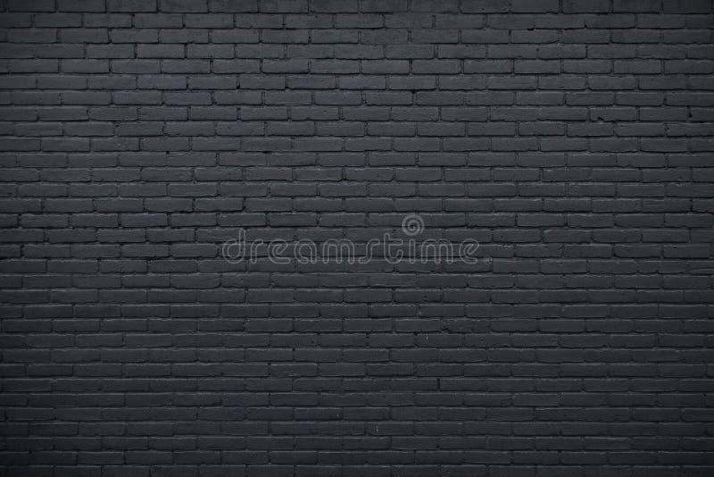 Del av den svart målade tegelstenväggen royaltyfri fotografi