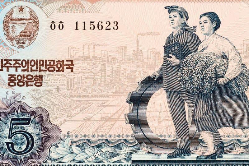 Del av gammal Nordkorea segrad bakgrund för sedel fem Högt upplösningstappningfoto av den nordkoreanska räkningen för averssida,  royaltyfri foto