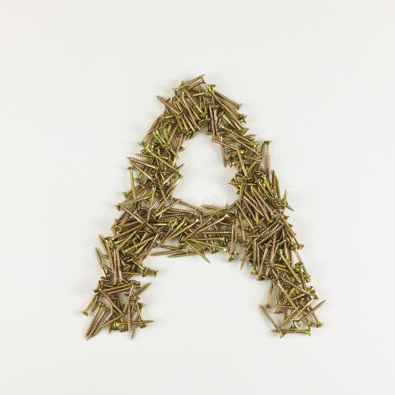 ` del ` A della lettera di alfabeto fatto con le viti galvanizzate su fondo bianco fotografie stock libere da diritti