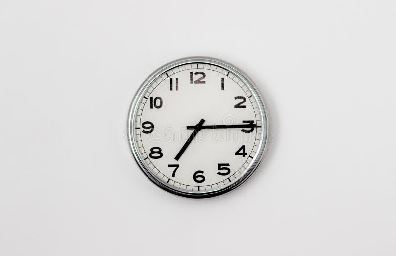 7:15 del reloj imagenes de archivo