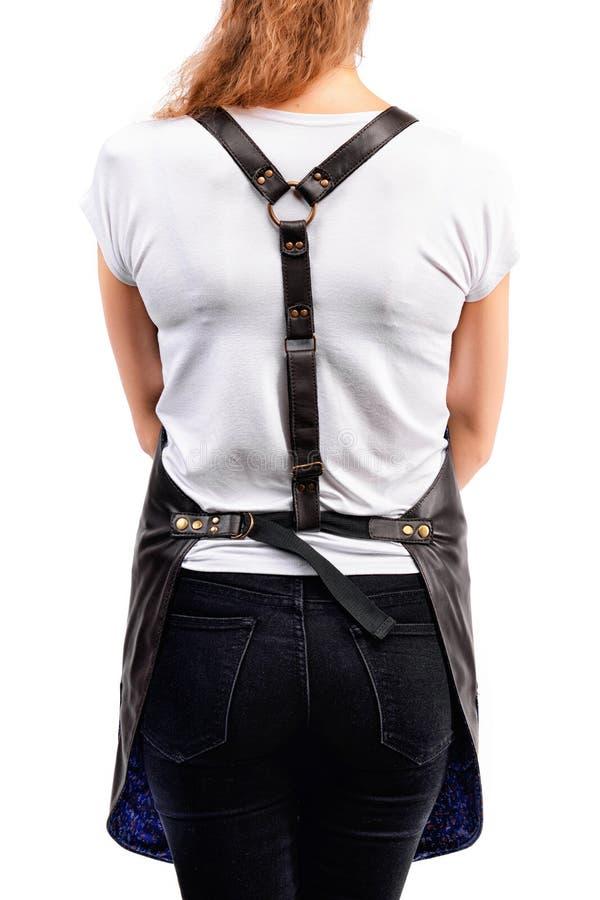 Delantal de presentación, que lleva pelirrojo joven del cocinero o del camarero de la mujer y camiseta aislados en el fondo blanc imágenes de archivo libres de regalías