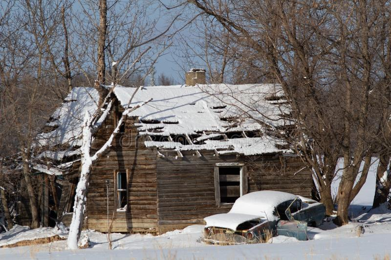 Delapidated car and cabin in winter. Car, cabin, winter, old, snow, cold, tree, freeze, frozen, hoise, house, home, wreck, broken, falling, down, collapse stock photography