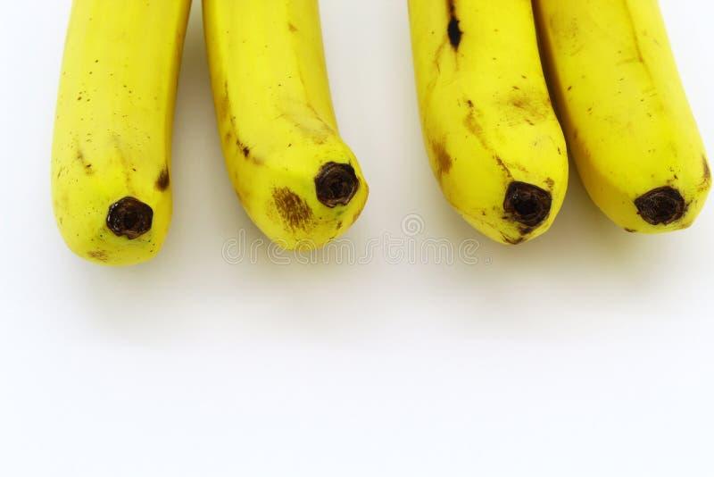 Delar av bananer på vit bakgrund arkivfoto