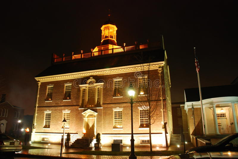 Delaware State Capitol at night. Delaware State Capitol building, located in Dover at night illuminated by a cressets. The Capitol is located on The Green stock image