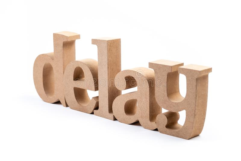 Delay Word Isolated. Delay word by wood alphabets isolated on white background stock image