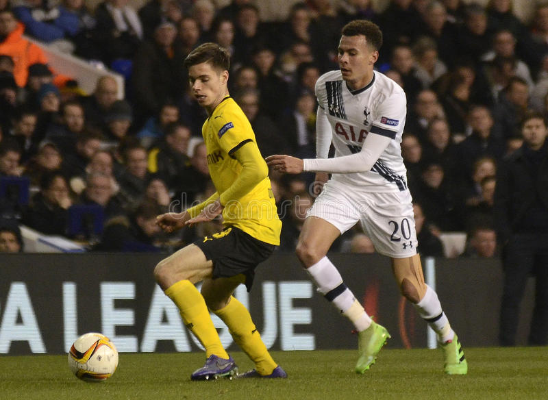 Dele Alli and Julian Weigl. Football players pictured during UEFA Europa League round of 16 game between Tottenham Hotspur and Borussia Dortmund on March 17 stock photo