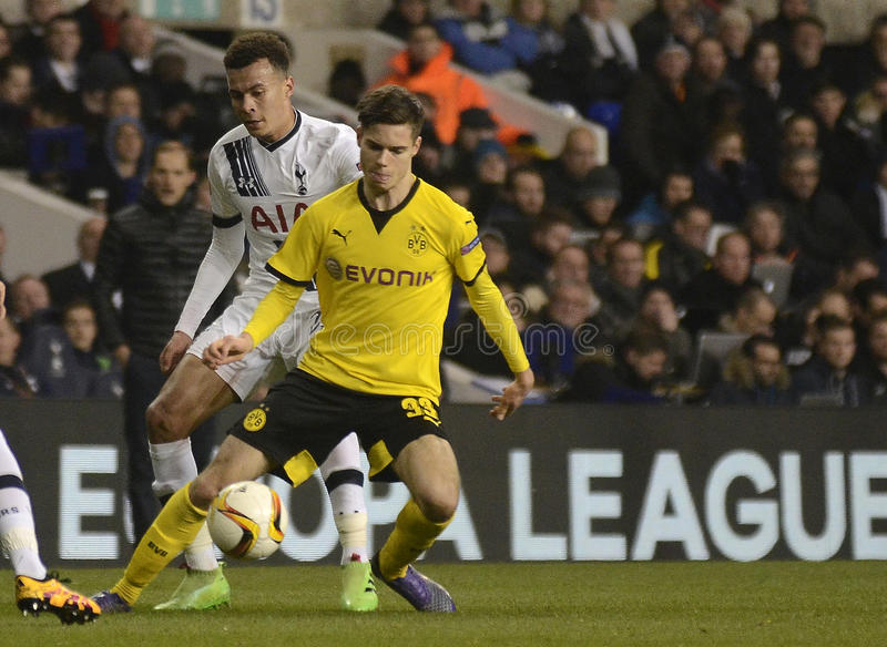 Dele Alli and Julian Weigl. Football players pictured during UEFA Europa League round of 16 game between Tottenham Hotspur and Borussia Dortmund on March 17 stock image