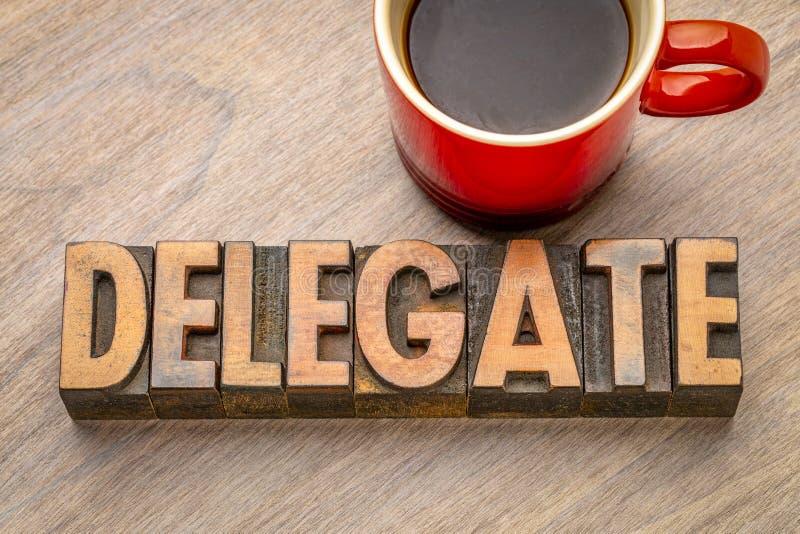 Delegat - ordabstrakt begrepp i tappningboktrycktyp royaltyfri foto