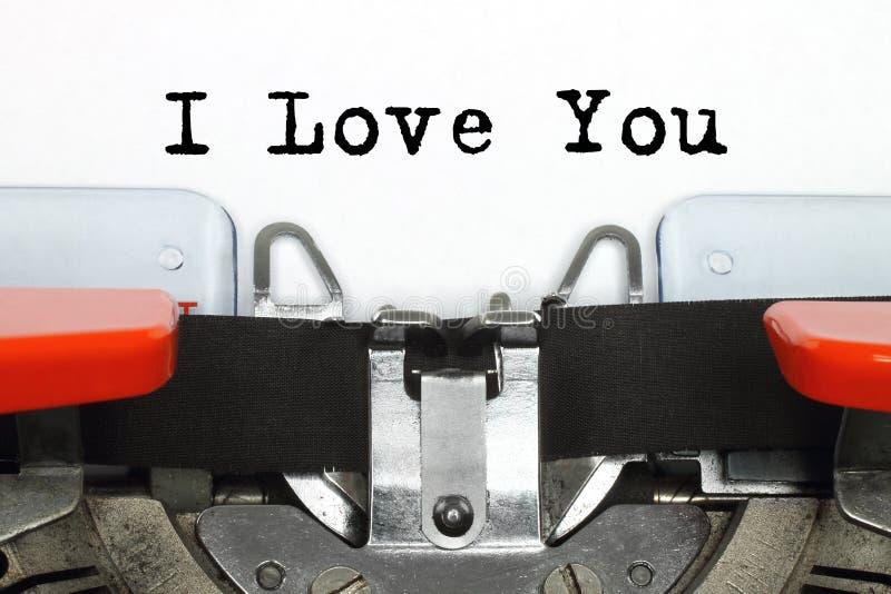 Delen av den skrev maskinskrivningmaskinen med älskar jag dig ord royaltyfri bild