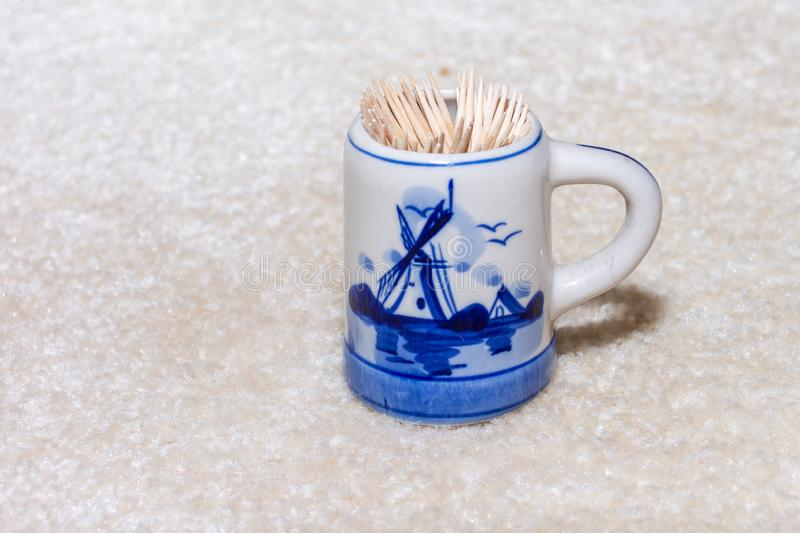 Delft Blue Figurine mug with windmill for toothpicks. Souvenir from Holland/Netherlands. Isolated on white background.  royalty free stock photos
