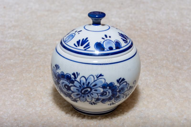 Delft Blue Tea porcelain serving dish. Souvenir from Holland/Netherlands. Close up  on beige background.  royalty free stock photos