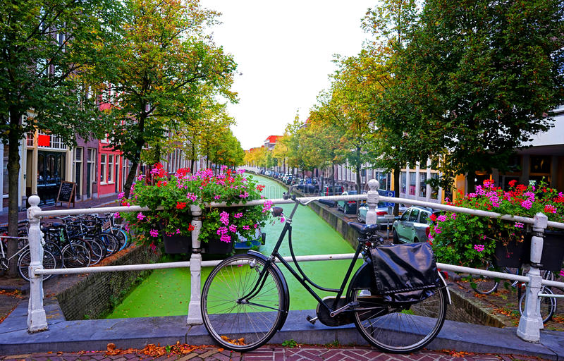 Delft canal. And retro bicycle on the bridge, Holland royalty free stock images