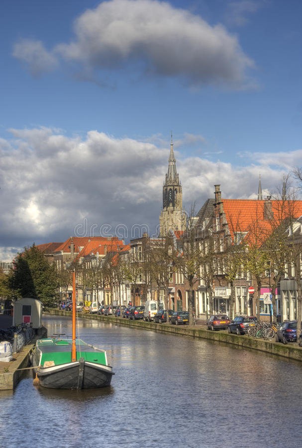 Delft, Holland. Canal, houses and church tower in historical centre of Delft, Holland stock image