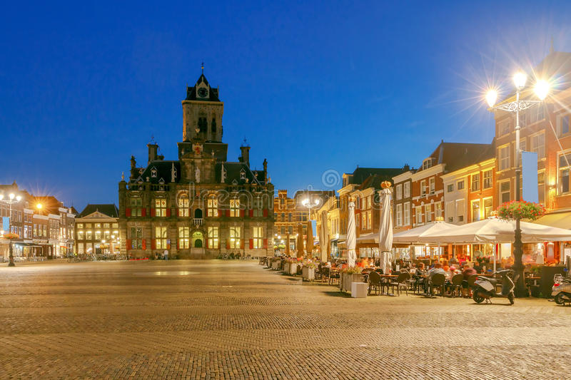 Delft. Market Square. The central market square and new church with a bell tower in the city Delft on sunset. Netherlands royalty free stock images