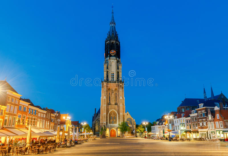 Delft. Market Square. The central market square and new church with a bell tower in the city Delft on sunset. Netherlands royalty free stock photos