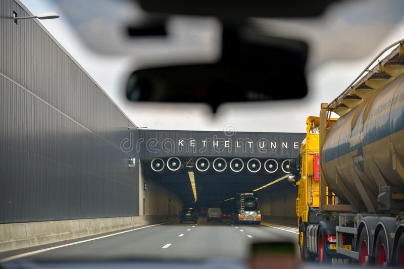 DELFT, NETHERLANDS - APRIL 15, 2019: Cars enter at the Kethel tunneltunnel. The a4 highway. DELFT, NETHERLANDS - APRIL 15, 2019: Cars enter at the Kethel royalty free stock photos