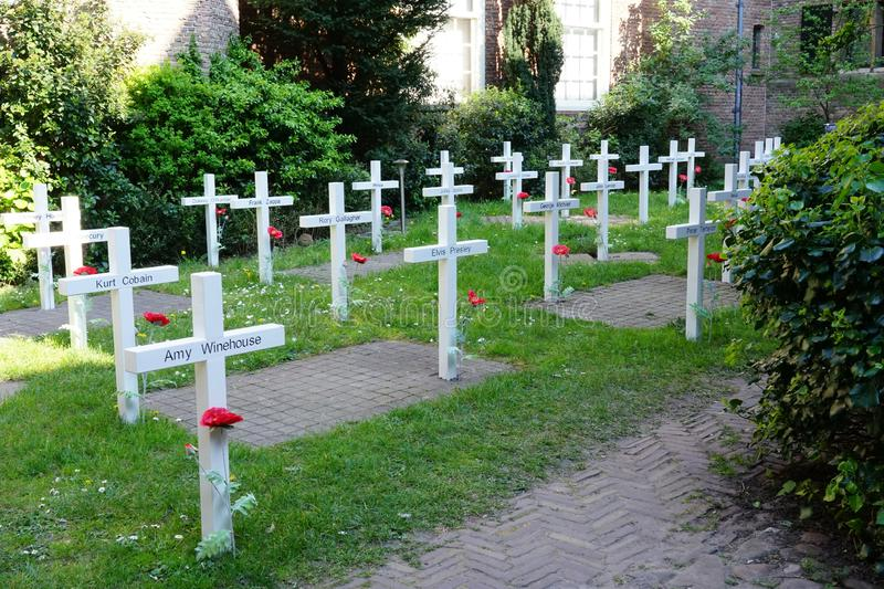 Delft, The Netherlands - April 21, 2019: Prinsenhof, Temporary cemetery which is part of the exhibition `Mojo backstage.'. Temporary cemetery which is part stock photography